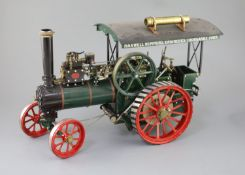 A Maxwell Hemmens Precision Steam Models agricultural traction engine, with green and red paintwork,