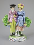 A Staffordshire pearlware group of a Dandy and Dandizette with seated dog, c.1820-30, each