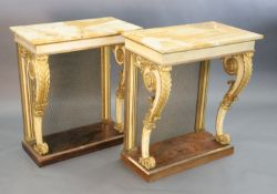A pair of William IV parcel gilt cream painted and rosewood console tables, with later marble tops