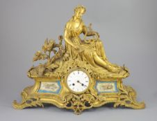 A 19th century French ormolu mantel clock, retailed by J & W Marshall, Paris, surmounted with a