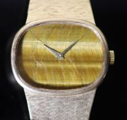 A gentleman's 1970's 9ct gold Bueche Girod manual wind dress wrist watch, on a 9ct gold bracelet,