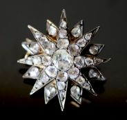 A 19th century French gold and foil backed rose cut diamond set starburst brooch, 23mm, gross 6.4