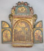 A 19th century Russian tempera on wood triptych icon, c.1800 with floral and bird carved crest,