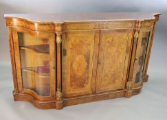 A Victorian figured walnut and marquetry side cabinet, with inlaid frieze and two panelled doors