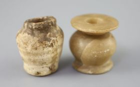 Two Egyptian alabaster cosmetic jars, c.1500 BC and Ptolemaic period (305-30 BC), the older jar with