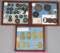 A group of 40 Japanese bronze and metal amulets or charms, 19th/20th century, largest 11.
