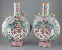 A pair of large Chinese turquoise ground famille rose moon flasks, Tongzhi seal mark and of the