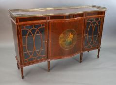 An Edwardian rosewood banded mahogany serpentine dwarf bookcase, with brass gallery and central door