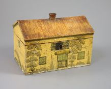 A Regency painted and penwork work box, modelled as a cottage, with leaded windows, plants around