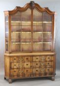 A late 18th century Dutch walnut serpentine vitrine, with moulded serpentine top, two barred