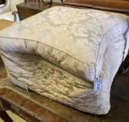An early 20th century upholstered concave sided footstool, width 65cm, height 42cm