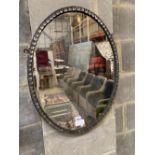 An oval Irish style wall mirror, width 48cm, height 64cm