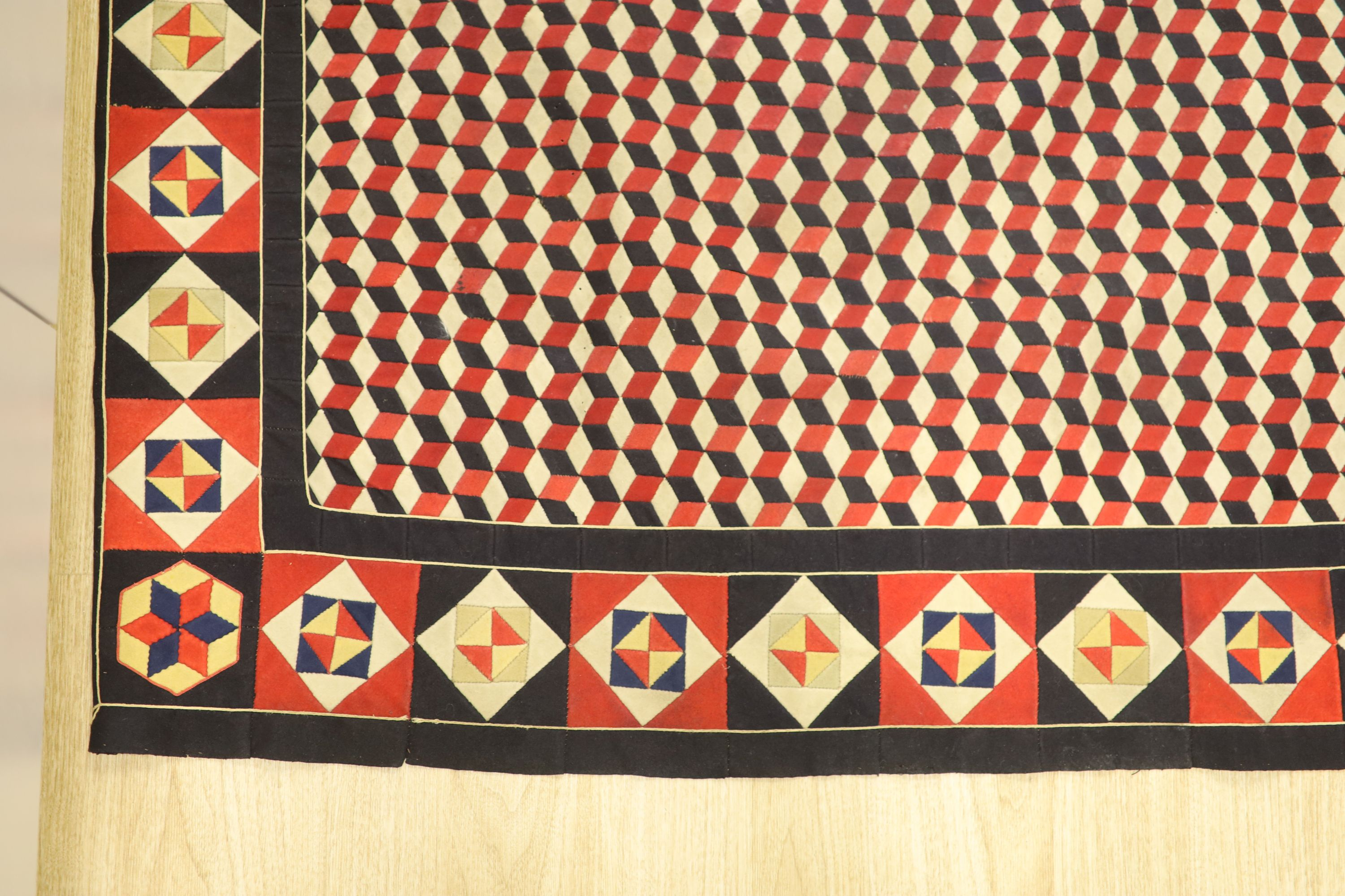 A 19th century 'Crimean' patchwork cover, made from military uniform felt in red, white, black and - Image 2 of 4