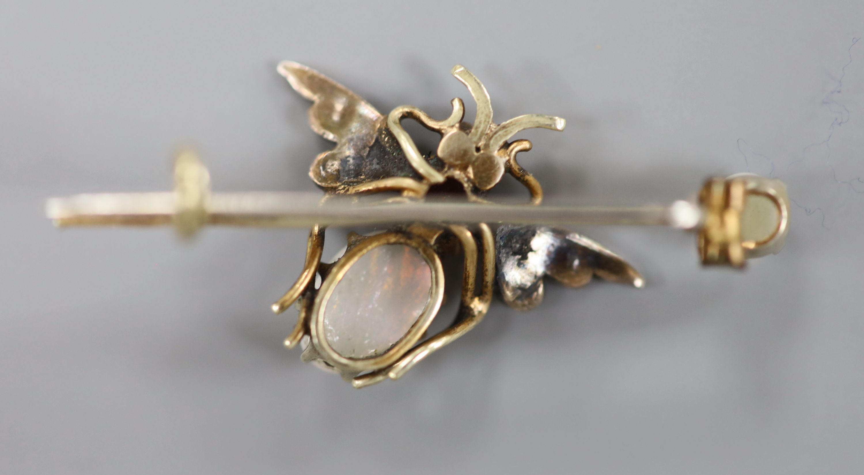 A Victorian yellow and white metal, white opal, garnet and seed pearl set bug brooch, 37mm, gross - Image 3 of 5