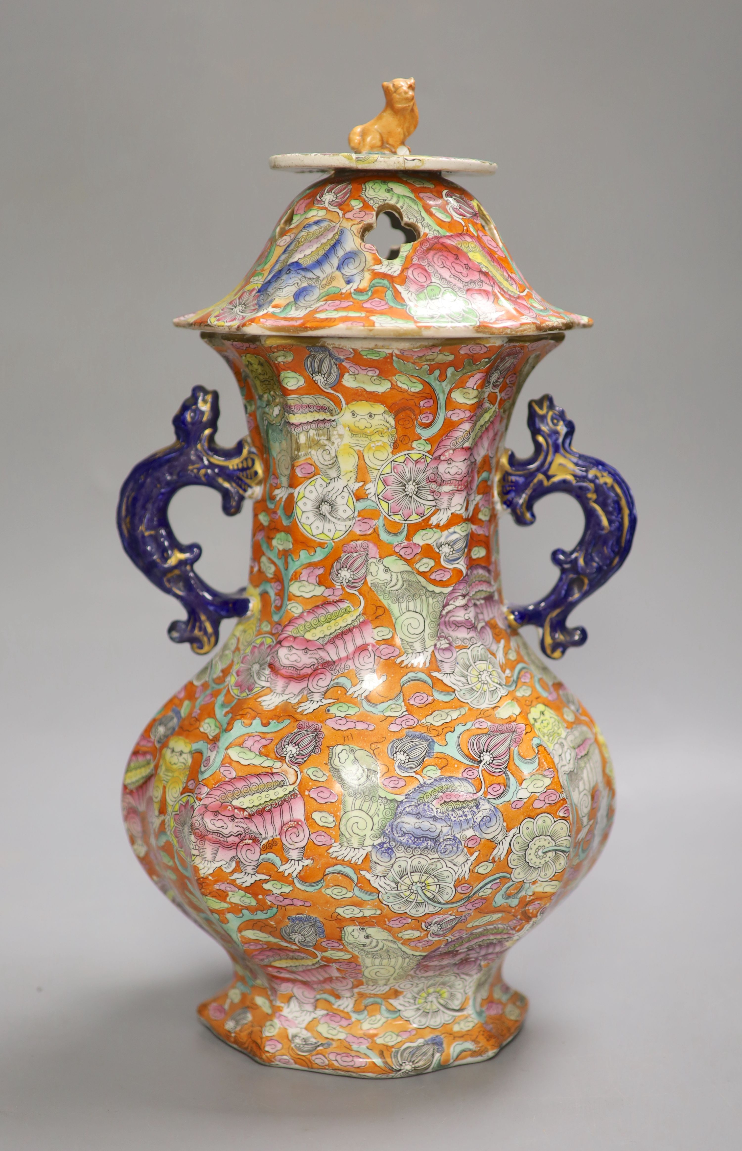 A 19th century chinoiserie ironstone vase and cover, height 41cm (a.f.)CONDITION: Cover modified,