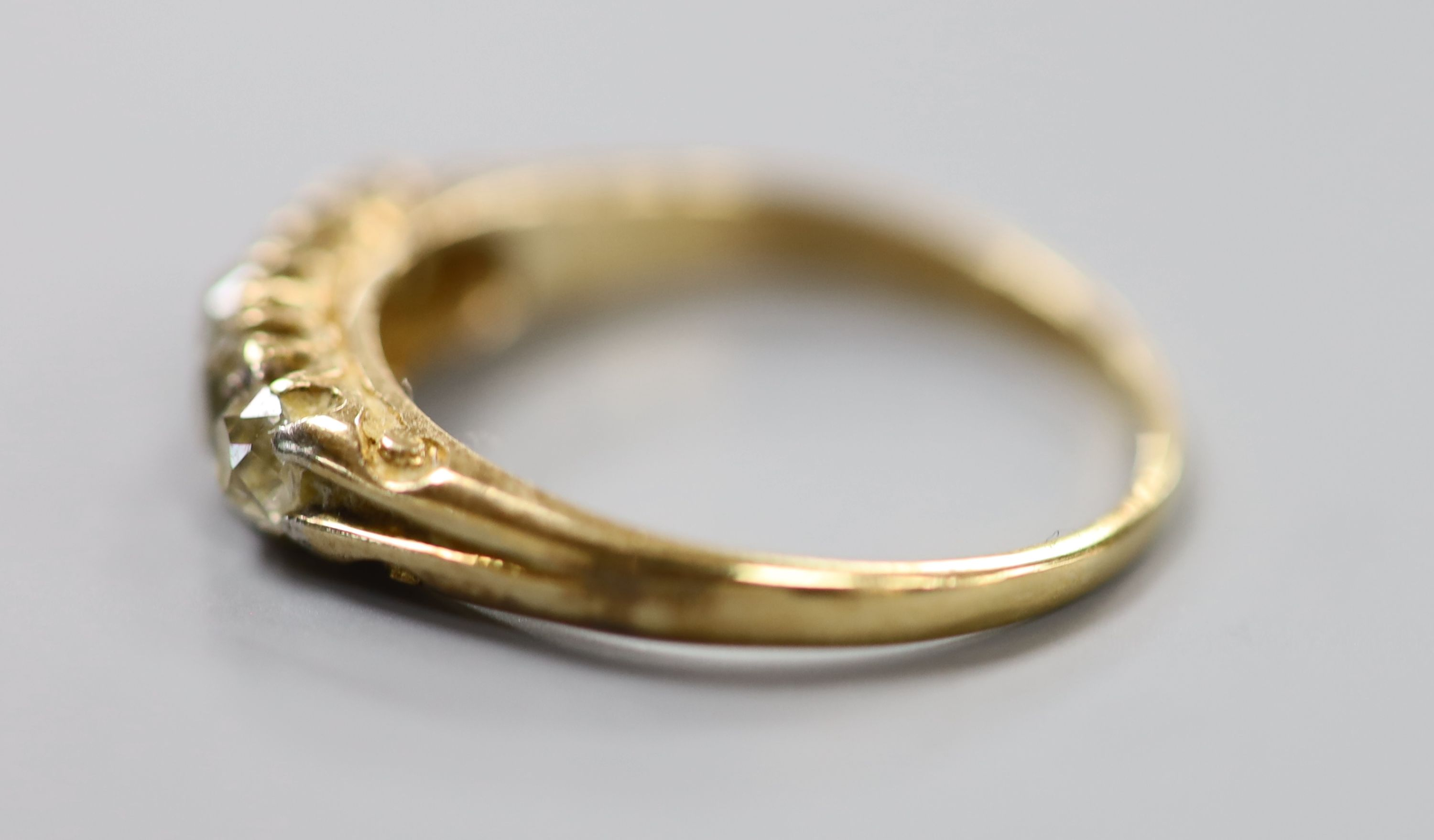 An early 20th century yellow metal and graduated five stone diamond set ring, size O, gross 2.6 - Image 2 of 3