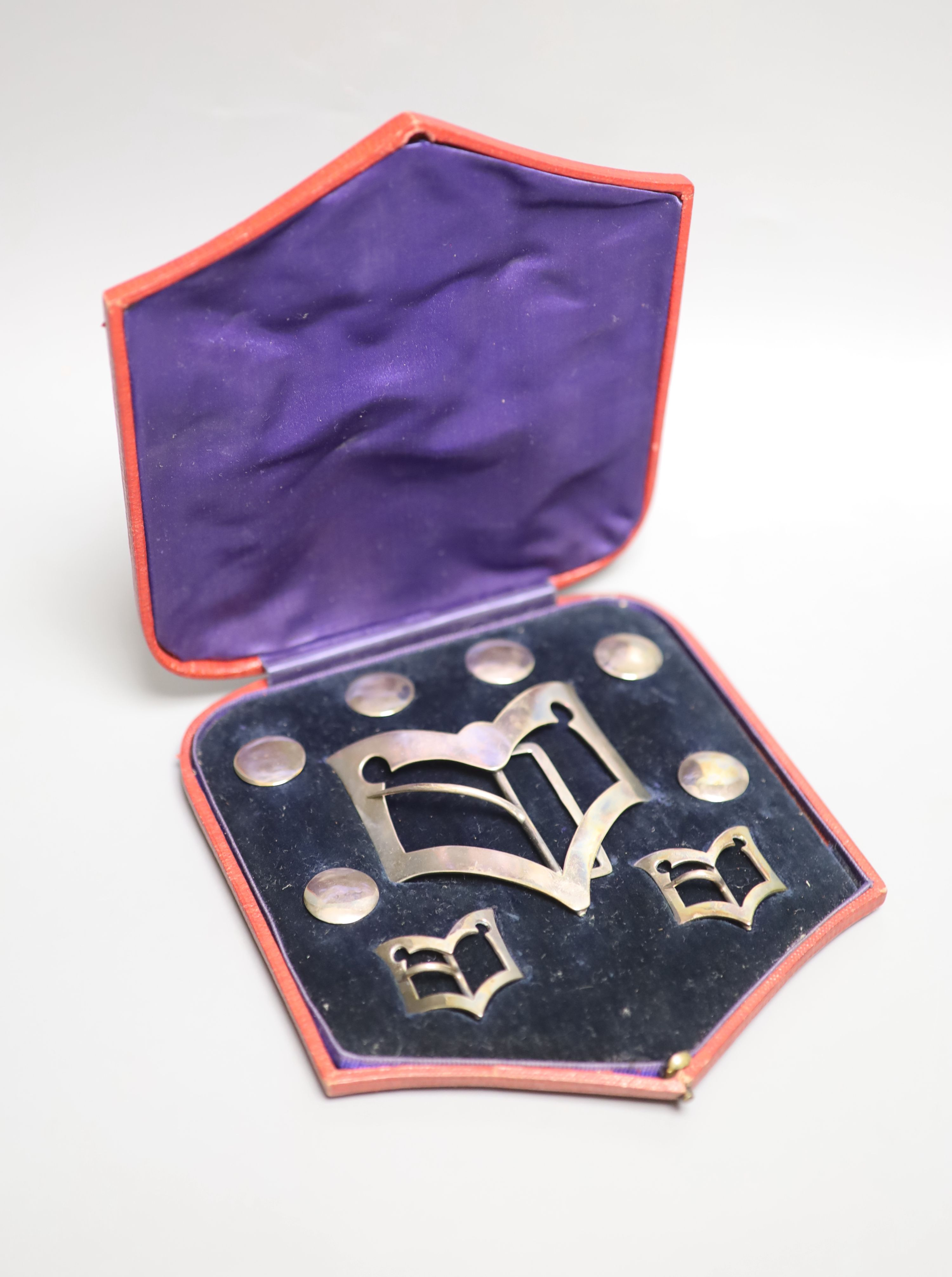 An Edwardian cased set of six silver buttons, belt buckle and pair of shoe buckles, Samuel Jacob,