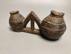 A Tribal wood double vessel, 21cm wide