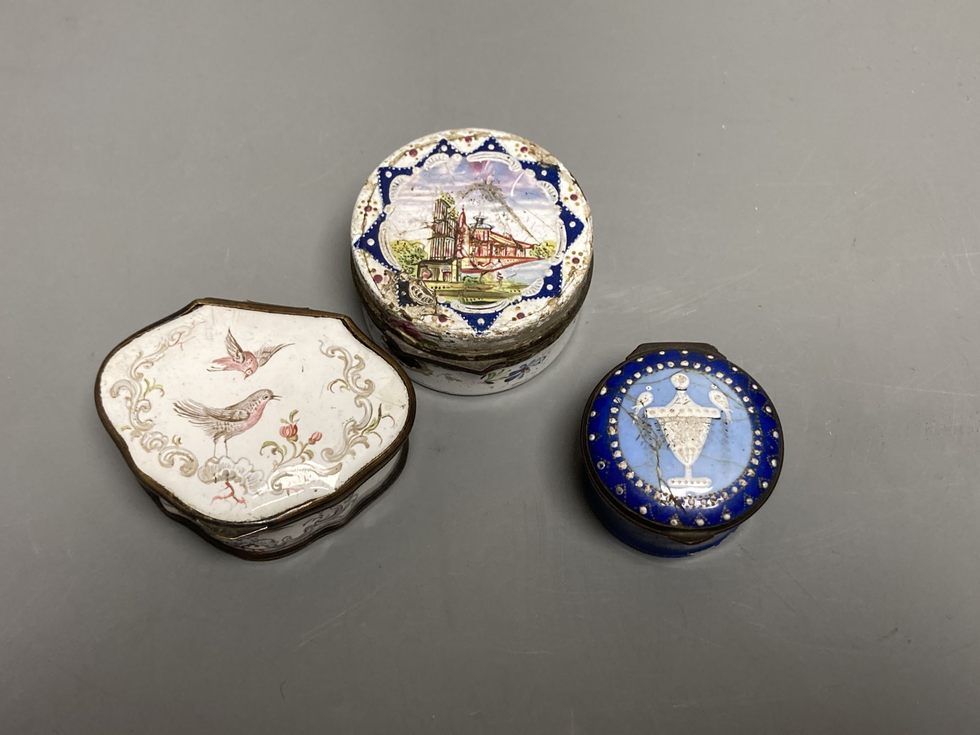 An 18th century white enamelled box painted with a palace, 5cm., a cartouche shaped box decorated - Image 2 of 3