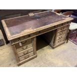 An early 20th century limed oak pedestal desk bears plaque 'Vaughan Williams O.M. composed at this