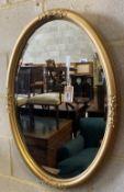 An early 20th century oval gilt framed wall mirror, width 55cm height 80cm