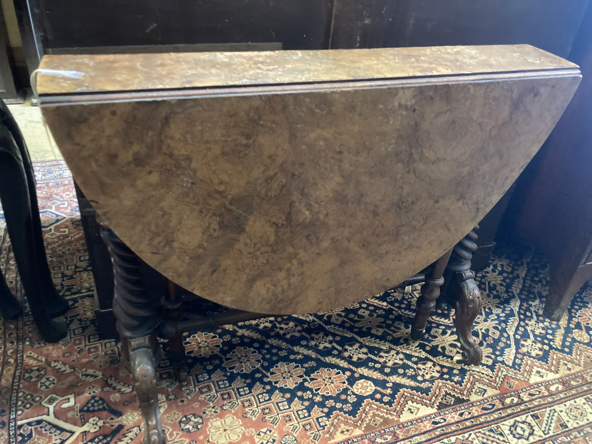 A Victorian walnut Sutherland table, width 89cm depth 17cm height 72cm