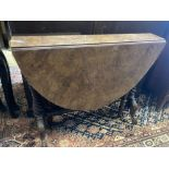 A Victorian walnut Sutherland table, width 89cm depth 17cm height 72cm