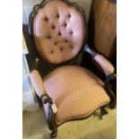 A Victorian mahogany framed buttoned back open armchair, width 66cm, depth 76cm, height 107cm