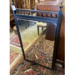 A late Victorian ebonised wall mirror, width 63cm height 110cm