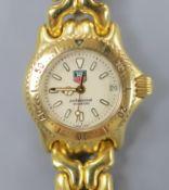A lady's modern gilt steel Tag Heuer Professional quartz wrist watch, cased diameter 23mm, ex.