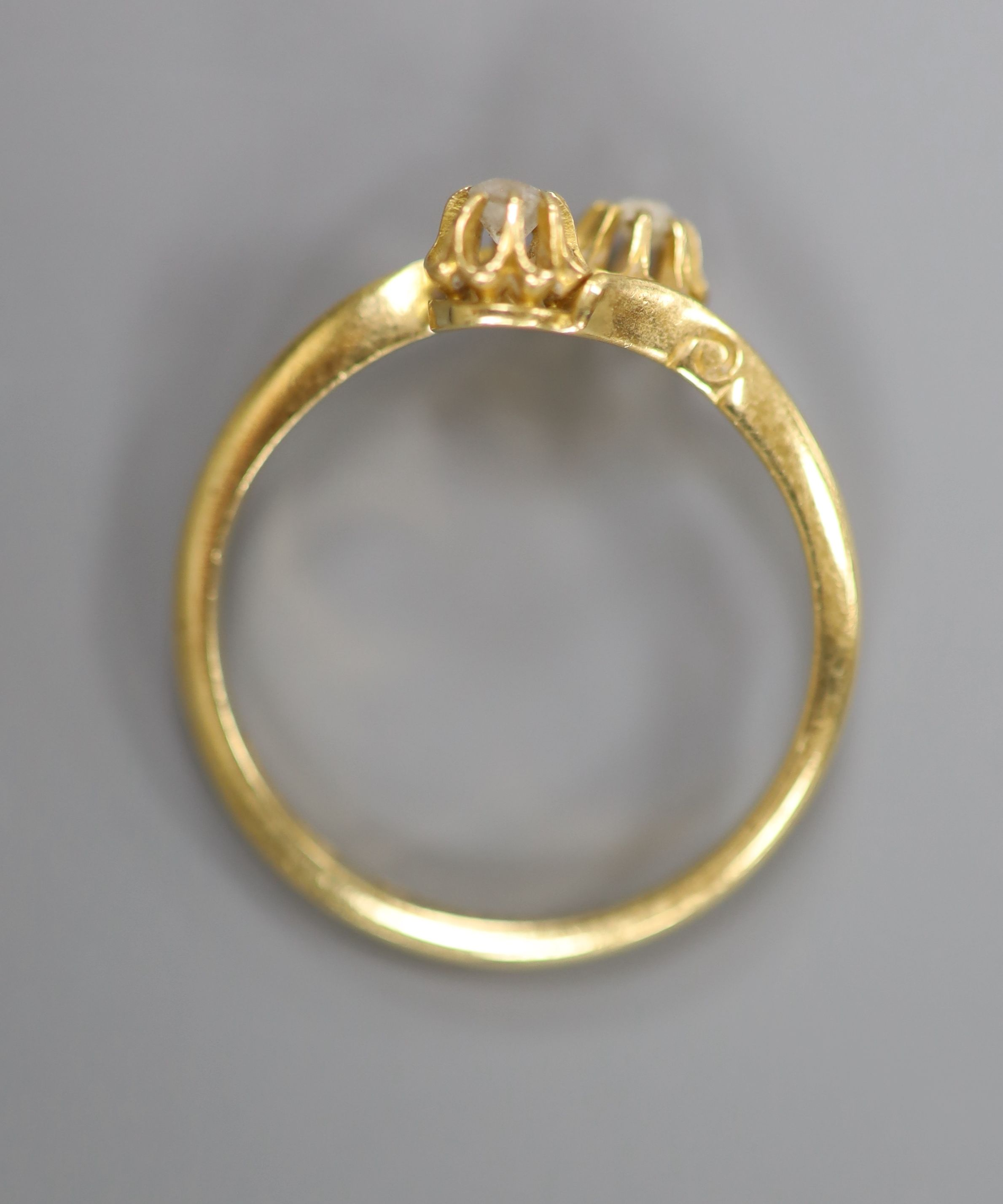 A George V 18ct gold and two stone diamond set crossover ring, size O/P, gross 2.7 grams. - Image 3 of 3