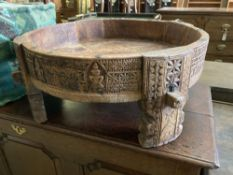 An African Islamic ceremonial circular carved hardwood table, 70cm diameter, height 29cm