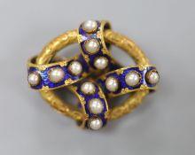 A Victorian yellow metal, blue enamel and split pearl set interwoven oval brooch, 35mm, gross 14