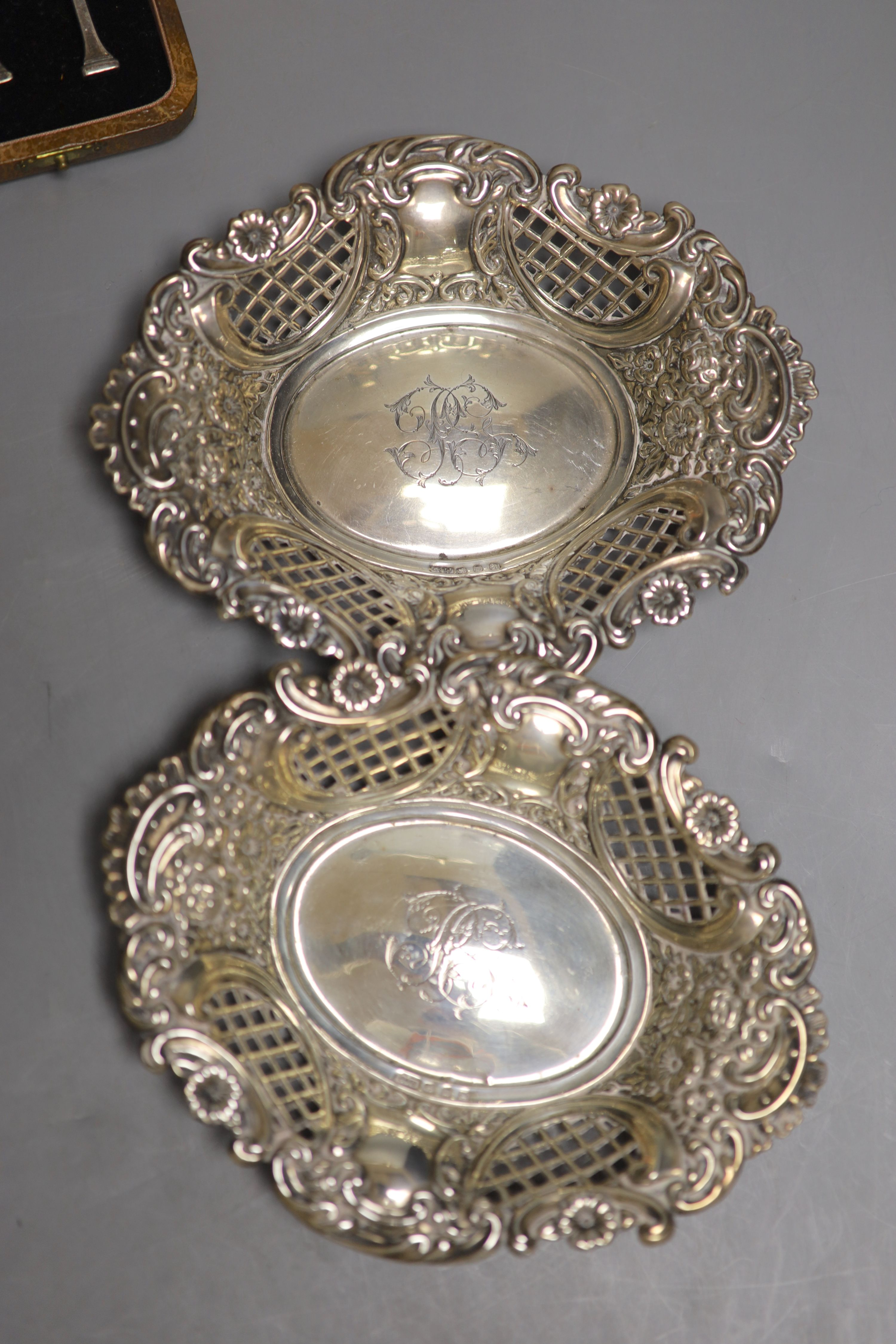 An Edwardian silver sugar caster, London, 1907, 17.6cm, a pair of late Victorian repousse silver - Image 2 of 4
