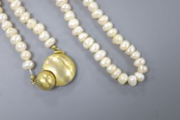 A modern single strand baroque pearl necklace, with yellow metal clasp, 45cm, gross 51.7 grams.
