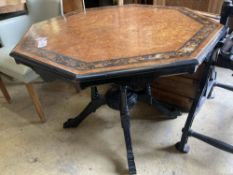 In the manner of Lamb of Manchester. An octagonal amboyna ebonised centre table, bear Southport