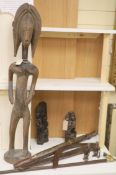 Ethnographia, a collection of various wood carvings, including an African tall female fertility