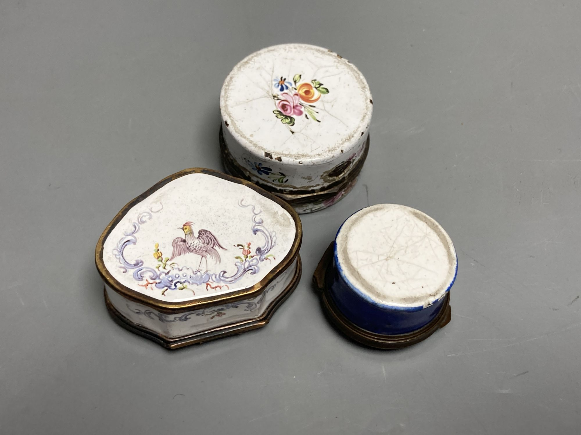 An 18th century white enamelled box painted with a palace, 5cm., a cartouche shaped box decorated - Image 3 of 3