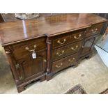 An 18th century style oak breakfront low dresser base, width 148cm, depth 47cm, height 83cm