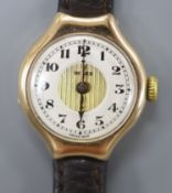 A lady's 1920's 9ct gold Rolex manual wind wrist watch, on associated leather strap, case diameter
