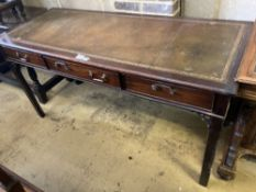A George III style mahogany three drawer writing table, width 150cm, depth 61cm, height 77cm