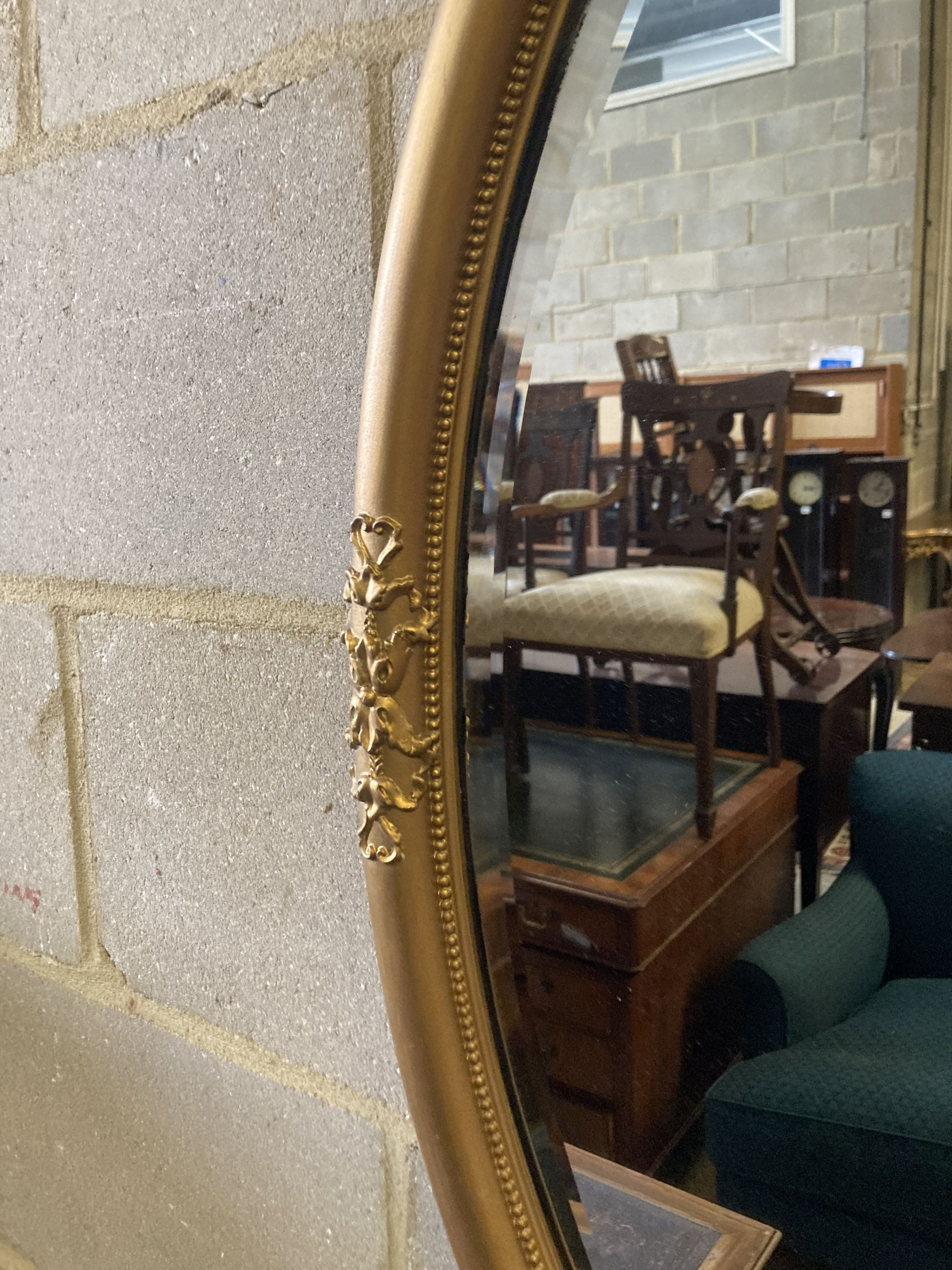 An early 20th century oval gilt framed wall mirror, width 55cm height 80cm - Image 2 of 3