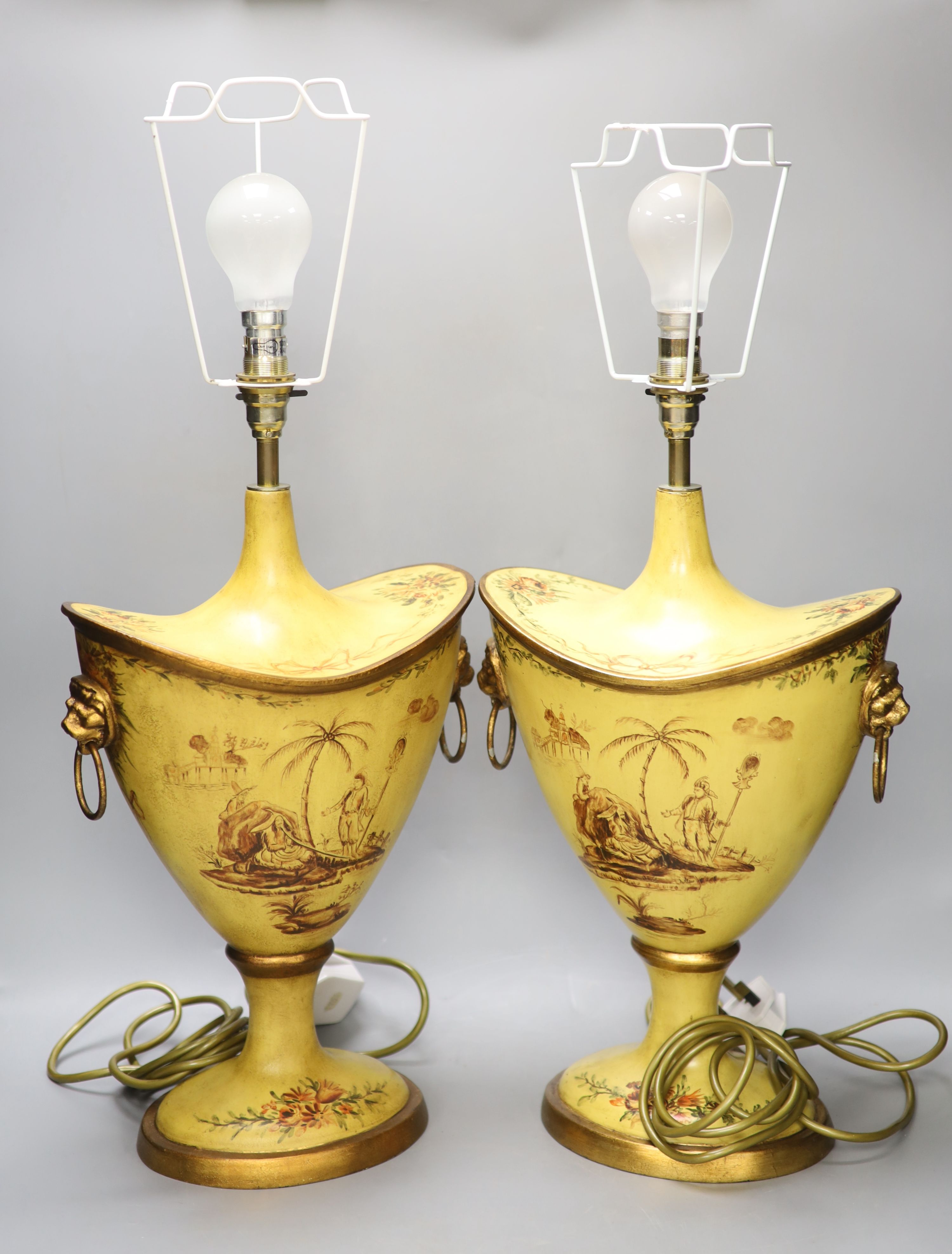 A pair of Regency style toleware lamps, height 40cm