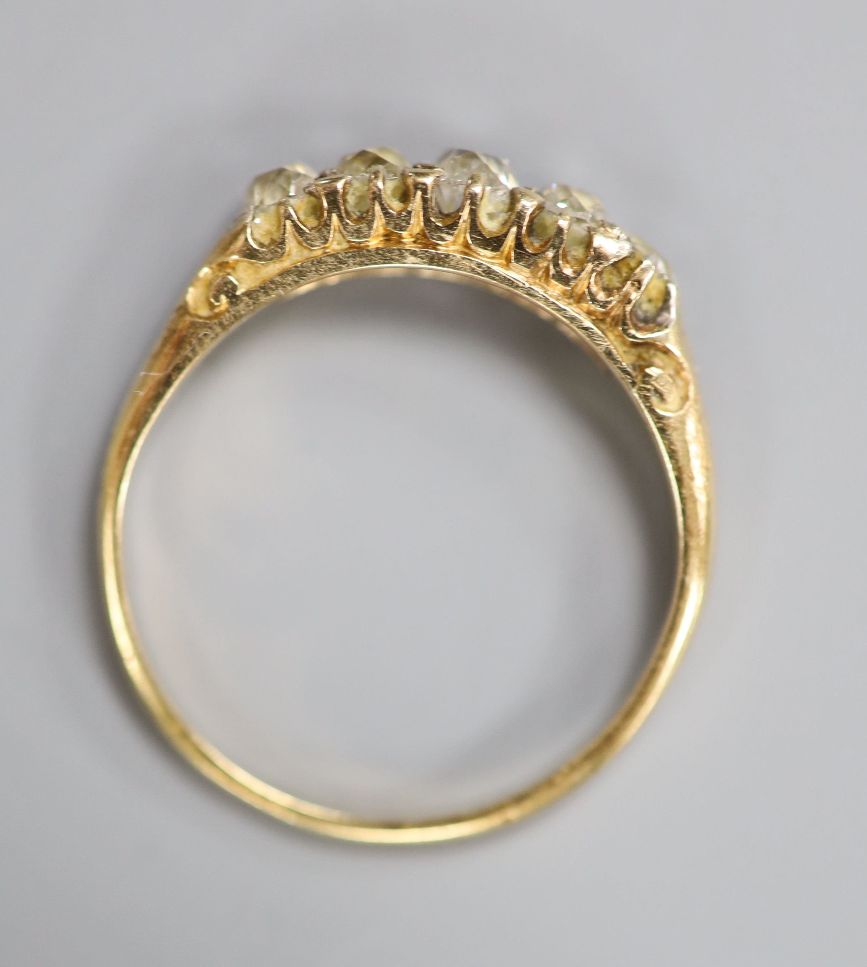 An early 20th century yellow metal and graduated five stone diamond set ring, size O, gross 2.6 - Image 3 of 3