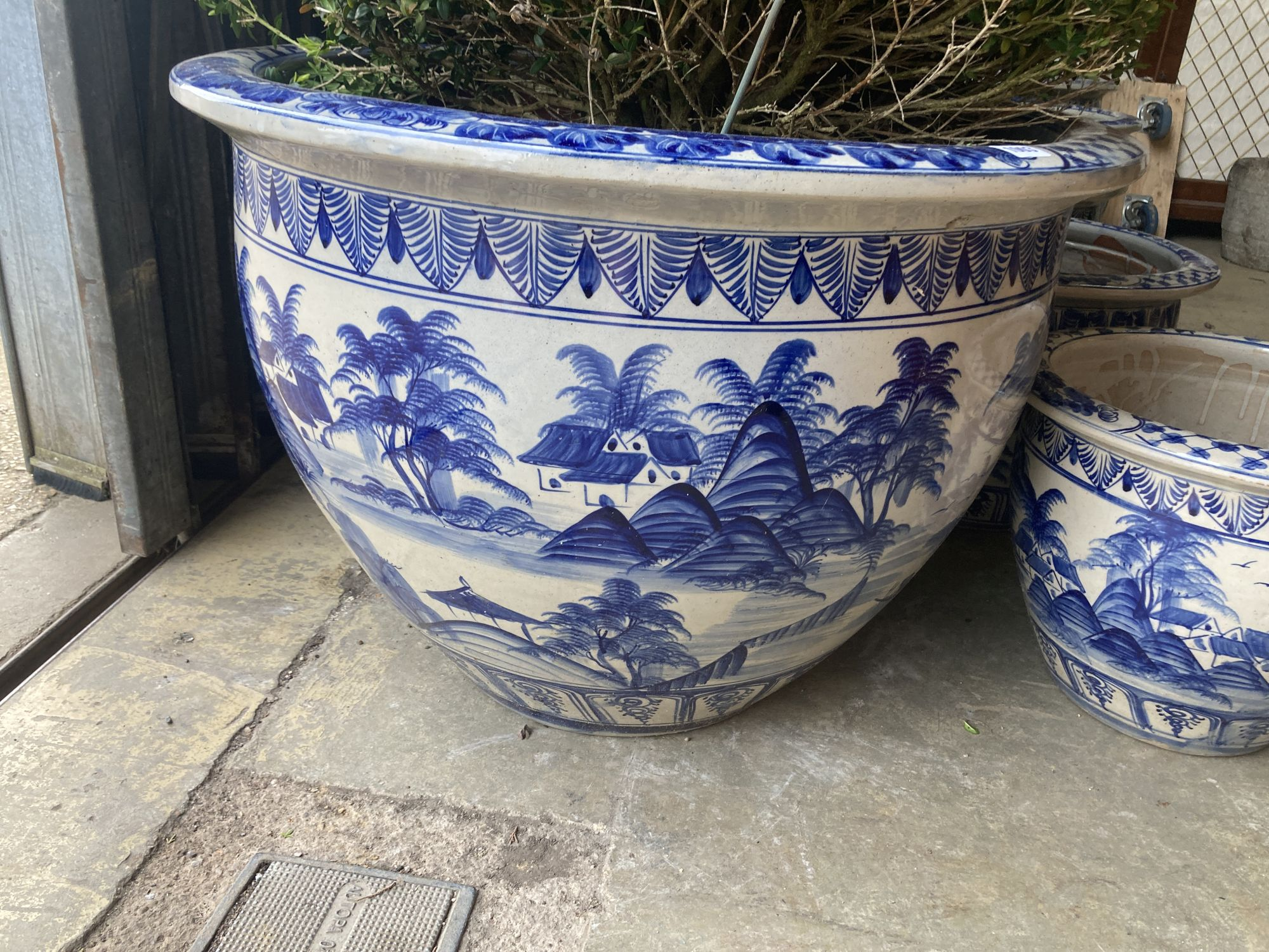 A graduated set of six Chinese style blue and white circular planters, largest width 70cm, height - Image 2 of 6