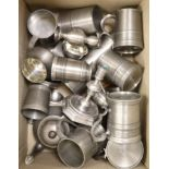 A quantity of pewter tankards, candlesticks etc.
