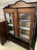 An Edwardian inlaid mahogany display cabinet, width 120cm, depth 35cm, height 175cm