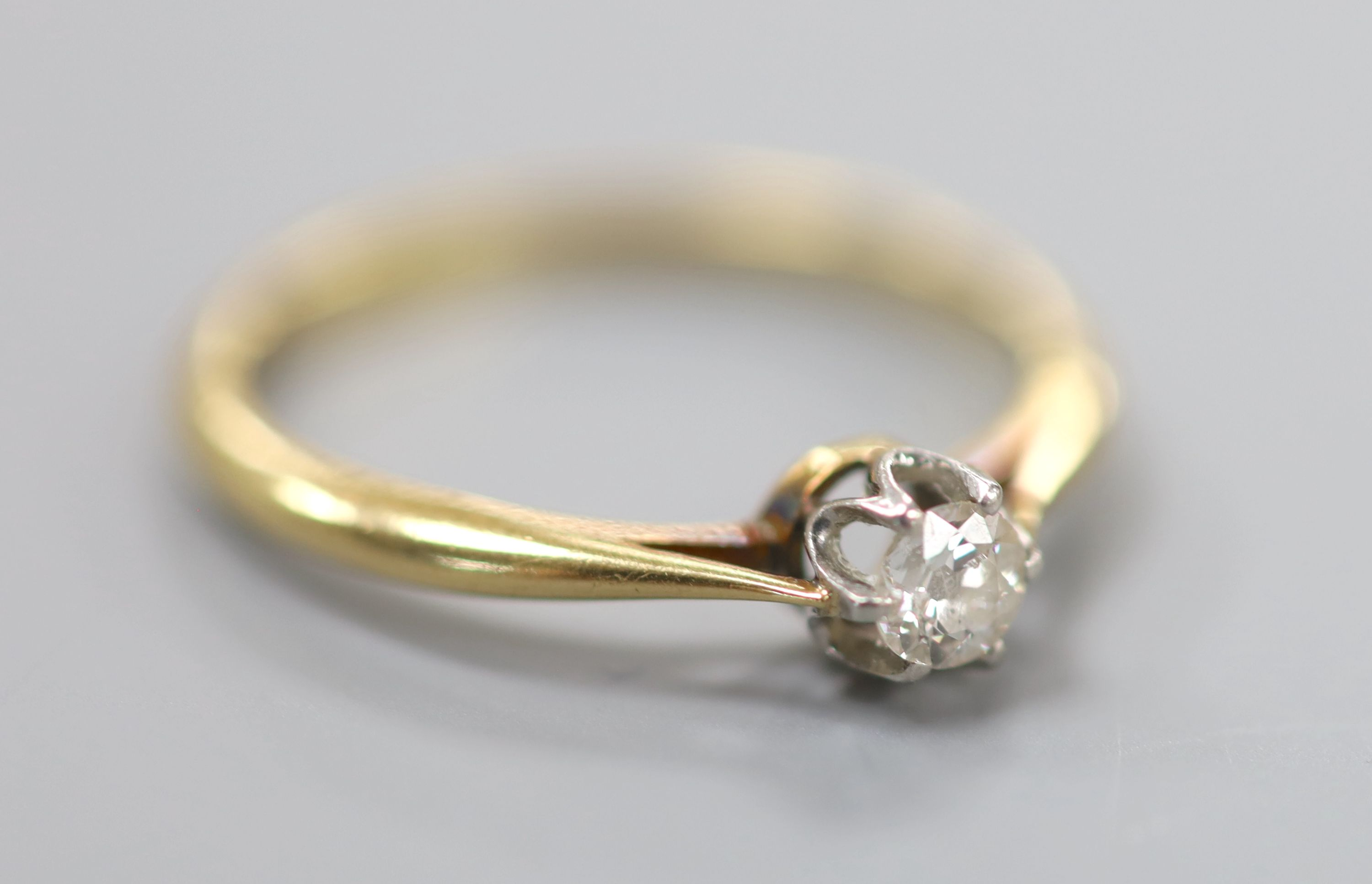 An 18ct and solitaire diamond ring, size Q, gross 2.5 grams, the stone weighing approximately 0.