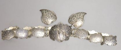 An early 20th century Russian white metal and niello belt, 74cm and a similar buckle, gross 5.5 oz.