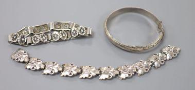 A 20th century Scandinavian 830S white metal stylised flower head bracelet, maker BH, 19cm, one